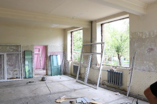 A room in a school being renovated with new windows about to be installed