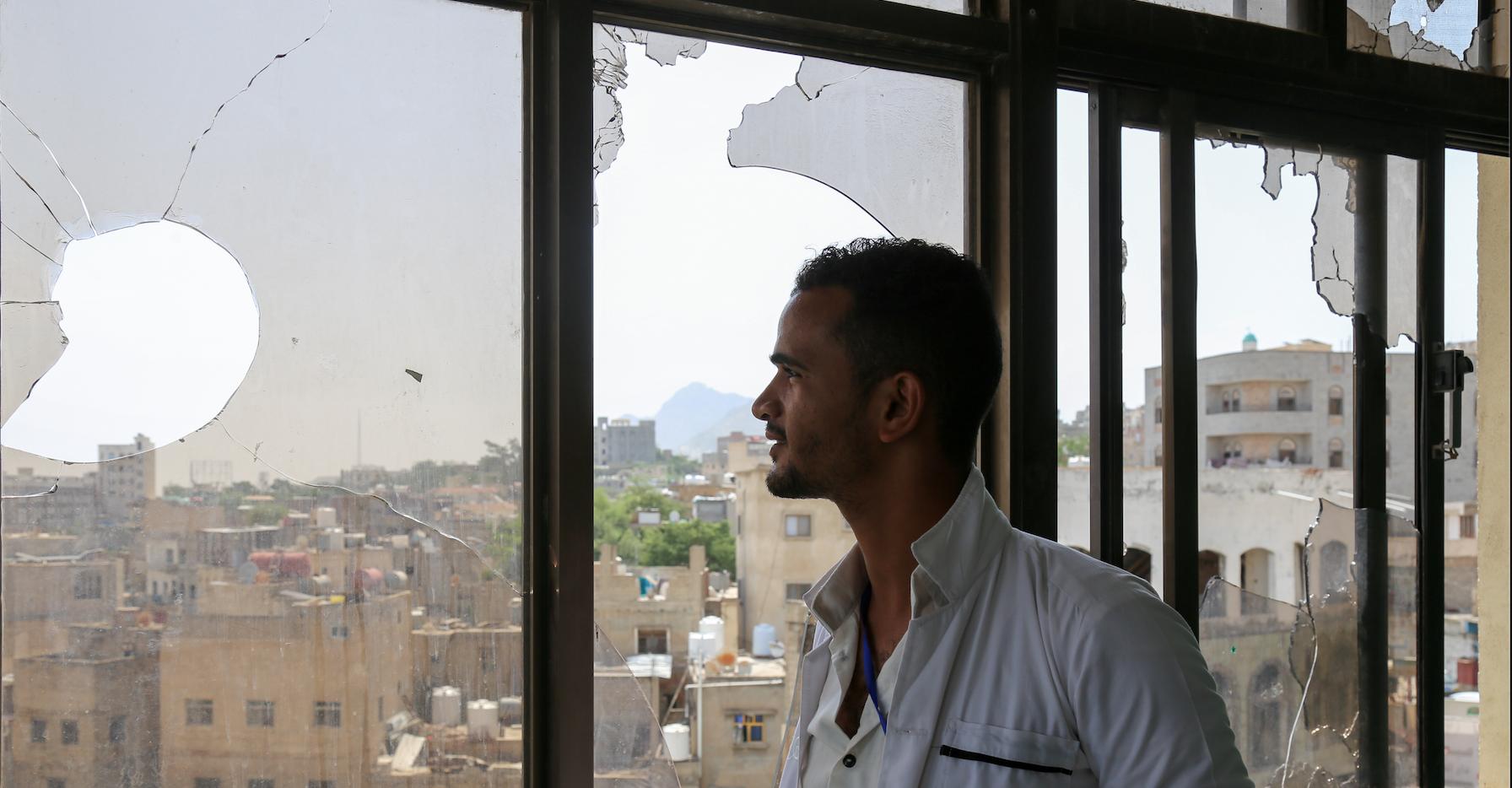 A man looking through the window in Yemen